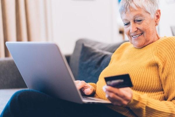 Modern Senior Woman Shopping Online