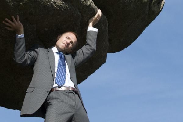 Businessman Struggling Outdoors Lifting Massive Heavy Boulder
