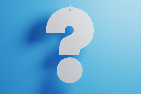 White Question Mark With String Over Blue Background